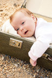 The baby in a suitcase Stock Photo