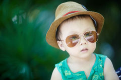 Baby in sun glasses Stock Images
