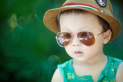 Baby in sun glasses Stock Photos
