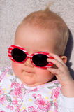 Baby with sunglasses. A baby-girl with sunglasses on Royalty Free Stock Photo