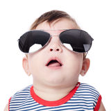 Baby with sunglasses isolated on white background Stock Photo
