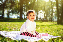 Baby on the sunny meadow Stock Image