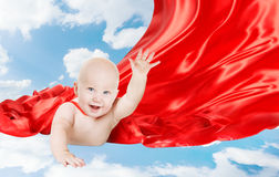 Baby Superhero, Kid Super Hero with Red Superman Cape, Child Boy. Flying in Blue Sky royalty free stock photo