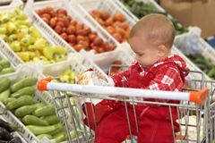 Baby in supermarket. Close up of baby in supermarket Royalty Free Stock Photos
