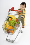Baby in the supermarket Royalty Free Stock Photos