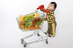 Baby in the supermarket Royalty Free Stock Photo