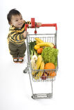 Baby in the supermarket Stock Images
