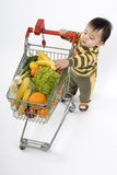 Baby in the supermarket royalty free stock photography
