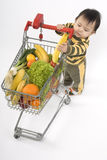 Baby in the supermarket Stock Image