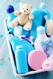 Baby supplies. Basket of baby supplies on blue background - baby time stock photo