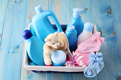 Baby supplies. Basket of baby supplies on blue background - baby time stock images