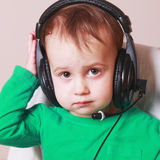 Baby support phone operator in headset (humorous photos) Royalty Free Stock Photography