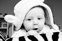 Baby Suprise. Cute 3 months old baby making a funny surprised face Royalty Free Stock Images