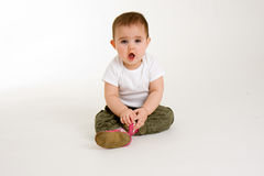 Baby Surprise. This is a baby who likes to make funny faces stock photo