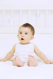 Baby surprised with bubbles Stock Photography
