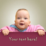 Baby with surprised expression Stock Photography