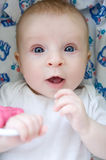 Baby with surprised face Stock Photography