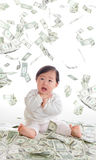 Baby surprised funny face with money rain. In the air isolated on a white background, concept for business, asian girl baby child royalty free stock photo