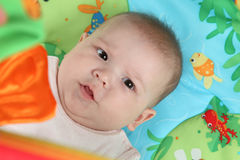 Baby surrounded by toys Royalty Free Stock Photo