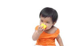 Baby swallowing or eating little things Royalty Free Stock Images