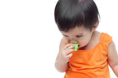 Baby swallowing or eating little things Royalty Free Stock Photo