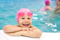 Baby swimmer. Portrait of little baby swimming  in swimming pool Stock Image