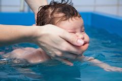 Baby swimming Stock Images
