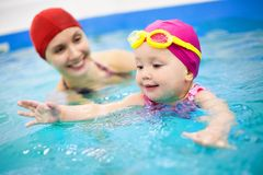 Baby swimming stock photography