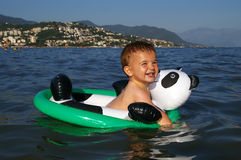 Baby Swimming. Summer pleasure. Cute baby swimming royalty free stock photos