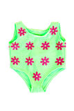 Baby swimming costume. A cute little green nylon baby swimming costume with red flowers. Image isolated on white studio background royalty free stock photography