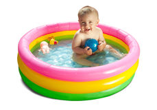 Baby swimming  in kid inflatable pool Stock Image