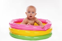 Baby swimming in kid inflatable pool Royalty Free Stock Photo
