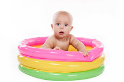 Baby swimming in kid inflatable pool Royalty Free Stock Photography