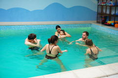 Baby swimming lessons Stock Photo