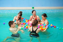 Baby swimming lessons Royalty Free Stock Photography