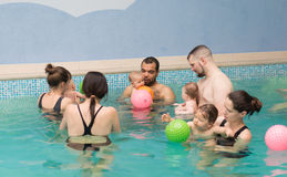 Baby swimming lessons Stock Photography