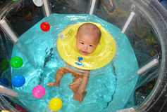 Baby swimming Stock Photo