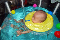 Baby swimming Stock Image