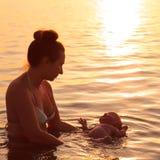 Baby swimming Royalty Free Stock Photos