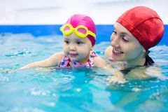 Baby swimming Royalty Free Stock Images