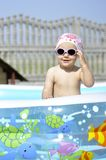 Baby in swimming pool Stock Photography
