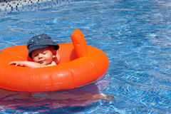 A baby in the swimming pool Stock Photos