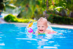 Baby in a swimming pool Stock Photos