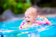 Baby in a swimming pool Stock Images