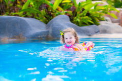 Baby in a swimming pool Royalty Free Stock Photos