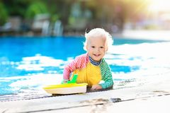 Baby in swimming pool. Family summer vacation. Royalty Free Stock Images