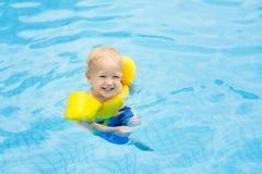 Baby in swimming pool. Kids swim. Royalty Free Stock Photo