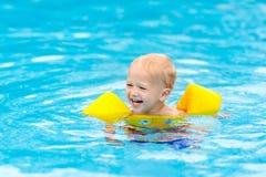 Baby in swimming pool. Kids swim. Stock Images
