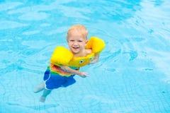 Baby in swimming pool. Kids swim. Stock Photos