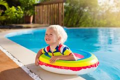Baby in swimming pool. Kids swim. Child summer fun. stock photography